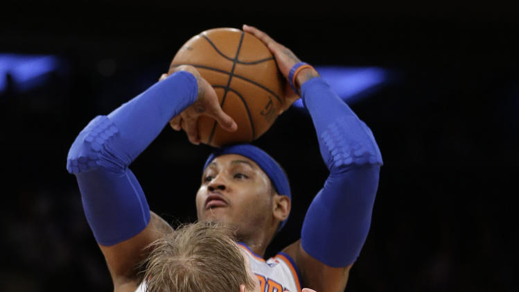 New York Knicks forward Carmelo Anthony shoots over Detroit Pistons guard Kyle Singler (25) in the first half an NBA basketball game at Madison Square Garden in New York, Monday, Feb. 4, 2013. (AP Photo/Kathy Willens)