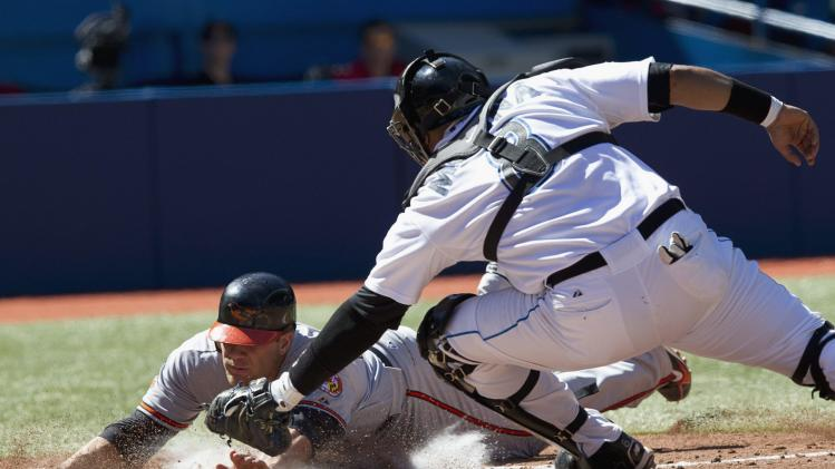 Toronto Blue Jays catcher Jose Molina tags out Baltimore Orioles Chris Davis at home plate during third inning baseball action against the Baltimore Orioles in Toronto on Saturday, Sept. 10, 2011. (AP Photo/The Canadian Press, Frank Gunn)