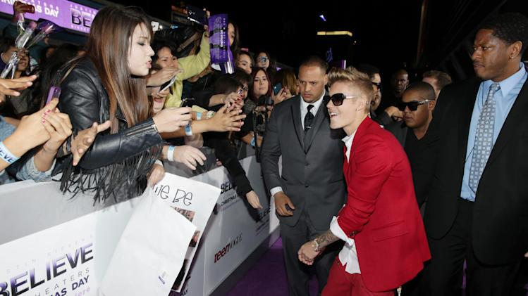 "Justin Bieber seen at the World Premiere of Open Road's ""Justin Bieber's Believe"" presented by Teen Vogue and sponsored by Clearasil, on Wednesday, Dec. 18, 2013 in Los Angeles. (Photo by Eric Charbonneau/Invision for Open Road Films/AP Images)"