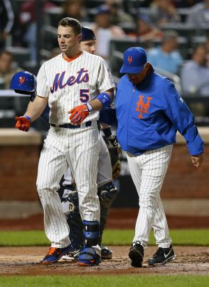 New York Mets David Wright (5) is escorted off the field by New York Mets manager Terry Collins after Wright was hit by a pitch in the third inning of a baseball game against the Milwaukee Brewers at Citi Field in New York, Thursday, Sept. 26, 2013. (AP Photo/Paul J. Bereswill)