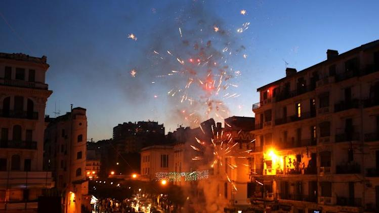 Fireworks explode in the sky over Algiers as supporters of incumbent President Abdelaziz Bouteflika celebrate after his victory in the presidential elections on April 18, 2014