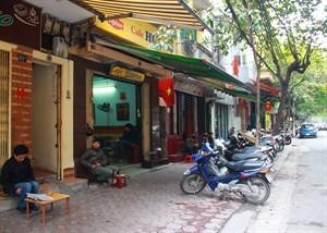 In this photo taken Jan. 5, 2013, customers drink coffee on Trieu Viet Vuong Street in Hanoi, Vietnam. Starbucks announced Thursday, Jan. 3, it would enter Vietnam in early February with a cafe in Ho Chi Minh City. But the Seattle-based company faces a unique market in Vietnam, where French-inspired coffee culture reigns supreme; two homegrown chains have established presences; and family-run sidewalk cafes are as ubiquitous as noodle shops. (AP Photo/Mike Ives)