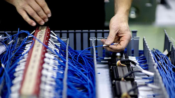 In this Tuesday, Jan. 15, 2013 photo, Jim Dunham, wires circuits for a control panel at Factory Automation Systems at the company's Atlanta facility. Factory Automation Systems cut 40 of 100 workers since the recession and instead is investing in automation and software. (AP Photo/David Goldman)