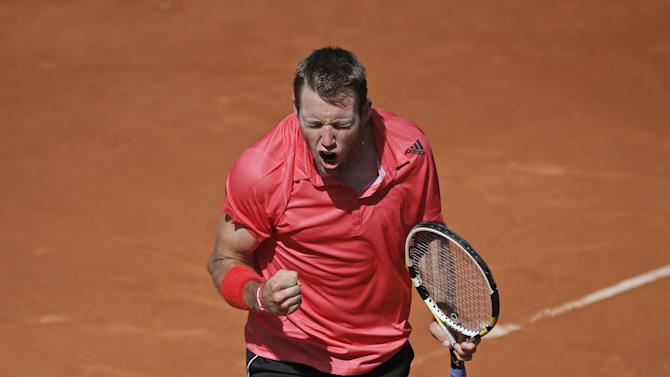 Jack Sock of the U.S. clenches his fist after scoring a point in the third round match of the French Open tennis tournament against Croatia's Borna Coric at the Roland Garros stadium, in Paris, France, Saturday, May 30, 2015. Sock won in three sets 6-2, 6-1, 6-4. (AP Photo/Christophe Ena)