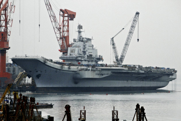 "In this photo taken on April 17, 2011, China's first aircraft carrier, former ""Varyag"" of Ukraine, is under restoration in a shipyard in Dalian in northeastern China's Liaoning province. China officia"