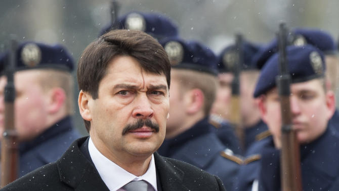 Hungarian President Janos Ader reviews the honor guards as he is welcomes by German President Joachim Gauck at Bellevue Palace in Berlin, Monday, March 11, 2013.  (AP Photo/Markus Schreiber)