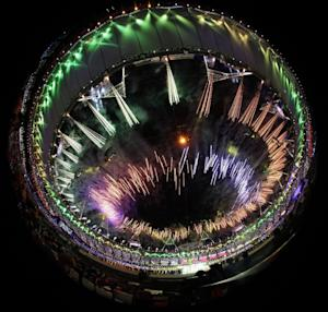 This image taken with a fisheye lens shows fireworks during the Closing Ceremony at the 2012 Summer Olympics, Sunday, Aug. 12, 2012, in London. (AP Photo/Charlie Riedel)
