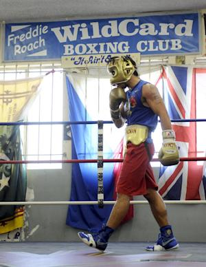 In this photo made Oct. 20, 2011, boxer Manny Pacquiao trains at the Wild Card Boxing Club in the Hollywood section of Los Angeles. Pacquiao is insulted by Juan Manuel Marquez's insistence that he won their first two fights. The pound-for-pound king is determined to leave no doubt next month. (AP Photo/Chris Carlson)