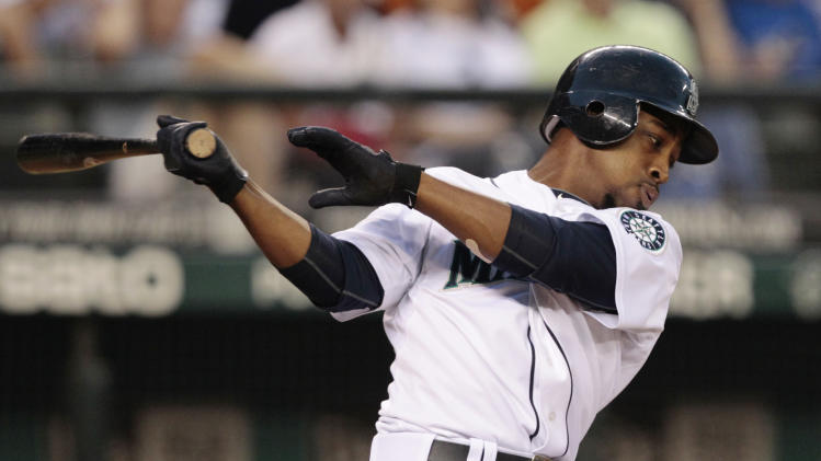 Seattle Mariners' Chone Figgins swings and misses on a pitch from the San Diego Padres in the eight inning in a baseball game Saturday, July 2, 2011, in Seattle. Figgins ground out on the turn. The Padres won 1-0. (AP Photo/Elaine Thompson)