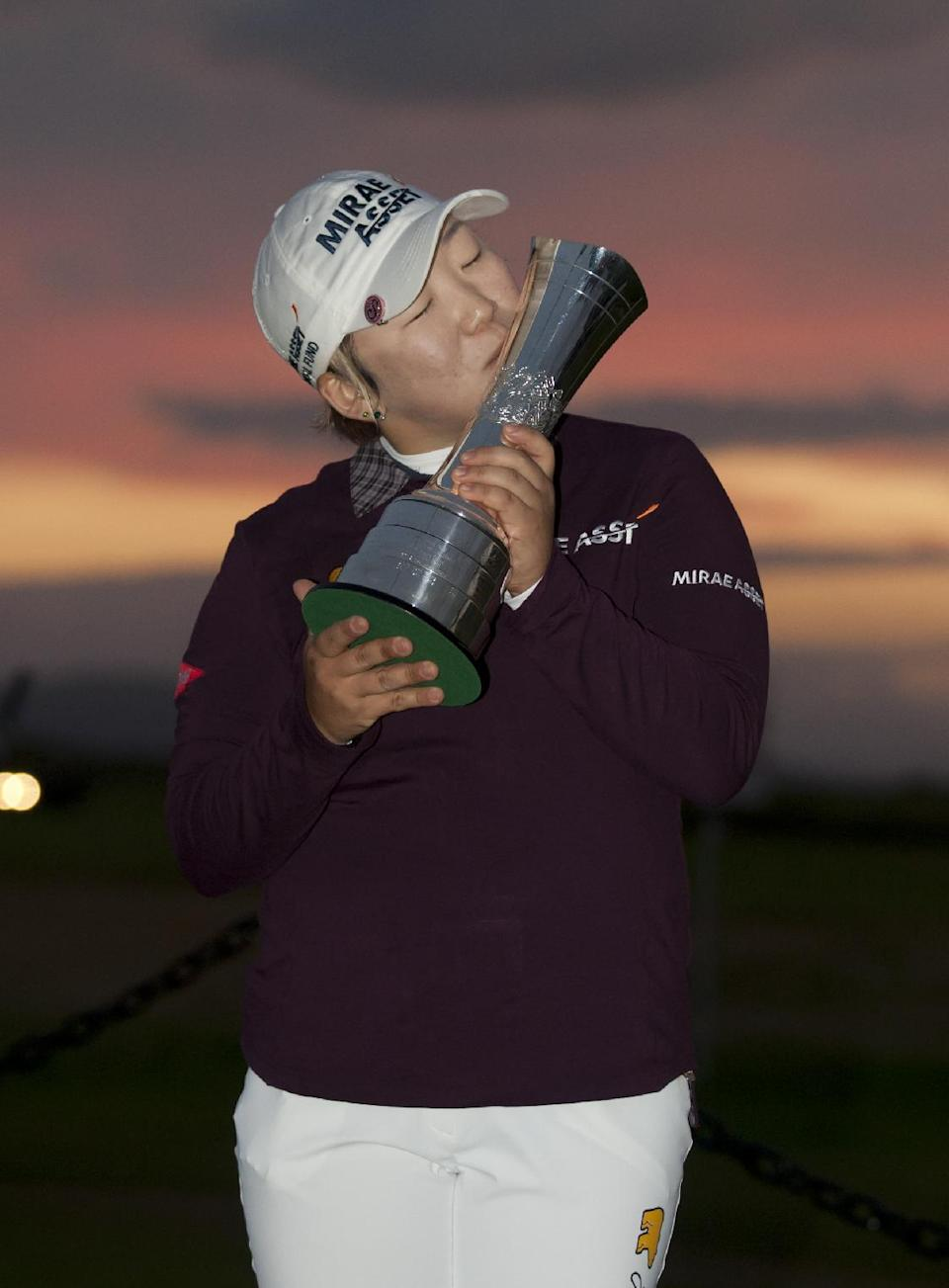 Korea's Jiyai Shin kisses the trophy after winning the Women's British Open golf championships at Royal Liverpool Golf Club, Hoylake, England, Sunday Sept. 16, 2012.  (AP Photo/Jon Super)