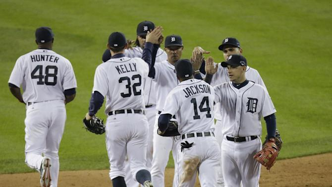 CORRECTS SCORE TO 7-3, INSTEAD OF 7-4 - The Detroit Tigers players celebrate after Game 4 of the American League baseball championship series against the Boston Red Sox, Wednesday, Oct. 16, 2013, in Detroit. The Tigers won 7-3. (AP Photo/Charlie Riedel)
