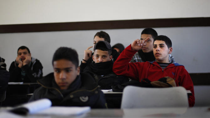 In this Sunday, Feb. 3, 2013 photograph, Palestinian students attend a class in a school in the West Bank city of Ramallah. A U.S.-funded study released Monday said both Israeli and Palestinian school books largely present one-sided narratives of the conflict between the two peoples and tend to ignore the existence of the other side, but rarely resort to demonization. (AP Photo/Majdi Mohammed)