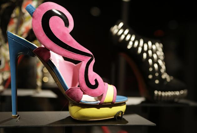 "This Feb. 11, 2013 photo shows a colorful mod shoe ""Cruise"" by Nicholas Kirkwood is displayed at the ""Shoe Obsession"" exhibit at The Museum at the Fashion Institute of Technology Museum in New York. T"