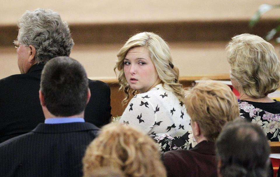 Hannah Anderson looks back into the crowd during the memorial service for her mother, Christina Anderson, and brother, Ethan Anderson at Guardian Angels Catholic Church on Saturday, Aug. 24, 2013 in Santee, California. (AP Photo/U-T San Diego, Howard Lipin, Pool)