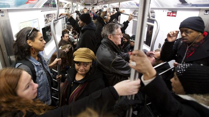 Commuters take the subway on Christmas Eve in New York