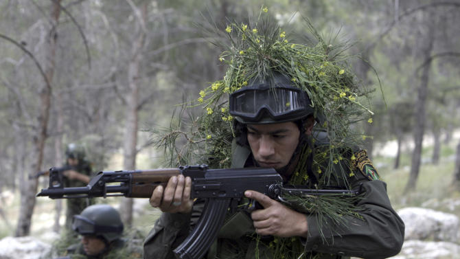 Palestinian security forces participate in an exercise in the West Bank city of Jenin, Thursday, April. 4, 2013. The force held a regular training to maintain the general readiness for security emergencies. (AP Photo/Mohammed Ballas).