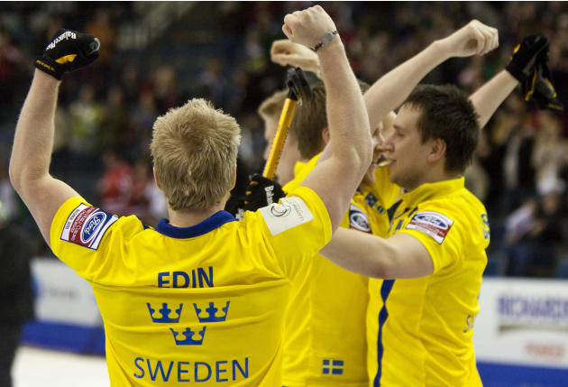 Skip Niklas Edin (L) celebrates Sweden's 7-6 win over Norway in the bronze medal match at the Ford World Men's Curling Championships in Regina, Saskatchewan, April 10, 2011.  AFP PHOTO / Geoff Robins
