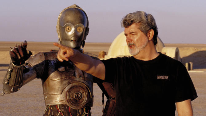 """** FILE ** In this undated publicity photo released by Lucasfilm Ltd. & TM, director George Lucas directs actor Anthony Daniels, who plays the robot C-3PO, in """"Star Wars II: Attack of the Clones,"""" on location in the Tunisian desert.  Lucasfilm said in a statement Monday, Jan. 28, 2013, that it's postponing the scheduled fall 3-D releases of """"Star Wars: Episode II - Attack Of The Clones"""" and """"Episode III - Revenge of the Sith"""" to instead focus its efforts on """"Star Wars: Episode VII.""""   (AP Photo/Lucasfilm Ltd. & TM, Lisa Tomasetti, file)"""