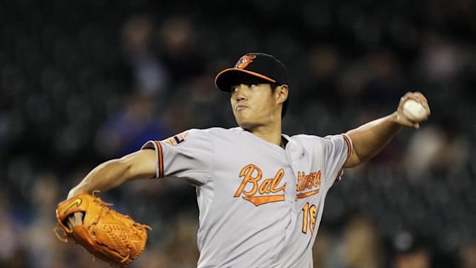 Baltimore Orioles starting pitcher Wei-Yin Chen,  of Taiwan, throws against the Seattle Mariners in the third inning of a baseball game, Tuesday, Sept. 18, 2012, in Seattle. (AP Photo/Ted S. Warren)