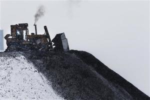 A bulldozer spreads processed coal at the Century Mine near Beallsville