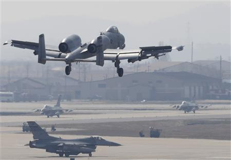 An A-10 jet (top) belonging to the U.S. Air Force comes in for a landing at a U.S. air force base in Osan, south of Seoul April 3, 2013. REUTERS/Lee Jae-Won