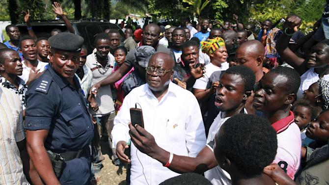 Opposition presidential candidate Nana Akufo-Addo, center, is surrounded by supporters as he leaves after voting, at the Rock of Ages Academy polling station in Kyebi, Ghana, Friday, Dec. 7, 2012. Ghanaians went to the polls Friday to choose between four candidates, including President John Dramani Mahama, the former vice president who ascended to the top post after   President John Atta Mills died in office in July, and Akufo-Addo, who lost the presidency by less than one percent in 2008. After five coups and decades of stagnation, the West African nation of 25 million is now a pacesetter for the continent's efforts to become democratic. (AP Photo/Christian Thompson)