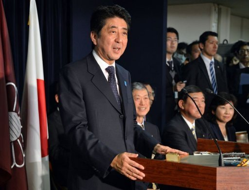 <p>Japan's incoming Prime Minister and leader of Liberal Democratic Party (LDP) Shinzo Abe (L) speaks to the media as he names new LDP party executives at their headquarters in Tokyo on December 25, 2012. Abe is to be named as the country's new prime minister Wednesday, after he swept to power on a hawkish platform of getting tough on diplomacy while fixing the economy.</p>