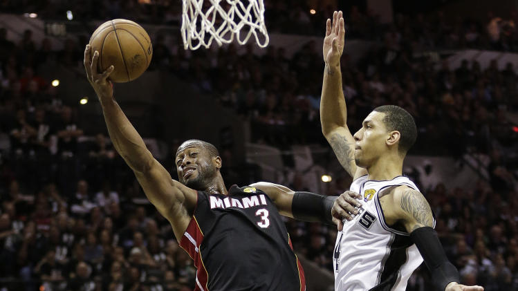 Miami Heat's Dwyane Wade (3) shoots against San Antonio Spurs' Danny Green (4) during the second half at Game 5 of the NBA Finals basketball series, Sunday, June 16, 2013, in San Antonio. (AP Photo/Eric Gay)