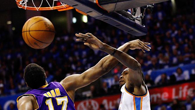 Oklahoma City Thunder forward Kevin Durant, right, dunks over Los Angeles Lakers Andrew Bynum (17) in the first quarter of Game 1 in the second round of the NBA basketball playoffs, in Oklahoma City, Monday, May 14, 2012. (AP Photo/Sue Ogrocki)
