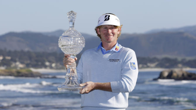 Brandt Snedeker poses with his trophy on the 18th green of the Pebble Beach Golf Links after winning the AT&T Pebble Beach Pro-Am golf tournament Sunday, Feb. 10, 2013, in Pebble Beach, Calif. Snedeker won the tournament after shooting a 7-under-par 65 to finish at total 19-under-par. (AP Photo/Eric Risberg)
