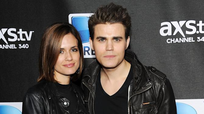 """FILE - This Feb. 2, 2013 file photo shows actors Paul Wesley, right, and his wife Torrey Devitto at DirecTV's Super Saturday Night party in New Orleans. Wesley, 31, who plays vampire Stefan Salvatore, is ending his marriage to wife Torrey DeVitto after two years of marriage. In a statement from DeVitto's publicist Mona Loring she said the couple """"decided to amicably split. They will continue to remain good friends."""" (Photo: Evan Agostini/Invision/AP, File)"""