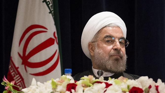 Iranian President Hassan Rouhani takes his chair before a news conference at the Millennium Hotel in midtown Manhattan, Friday, Sept. 27, 2013, in New York. (AP Photo/John Minchillo)