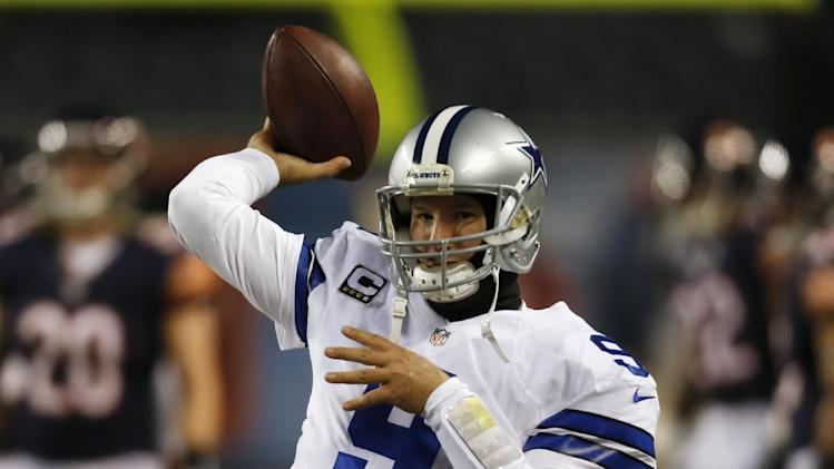 Dallas Cowboys quarterback Tony Romo (9) throws a pass during warmups before an NFL football game against the Chicago Bears, Monday, Dec. 9, 2013, in Chicago