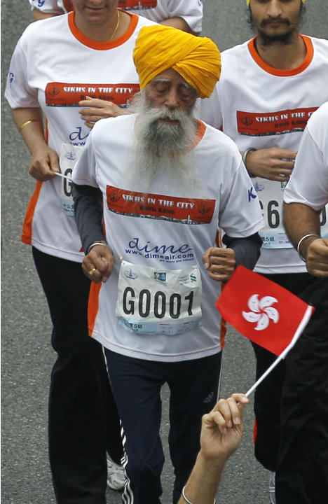 Centenarian marathon runner Fauja Singh, 101, originally from Beas Pind, in Jalandhar, India but who now lives in London, runs in a 10-kilometer race, part of the annual Hong Kong Marathon, in Hong Ko