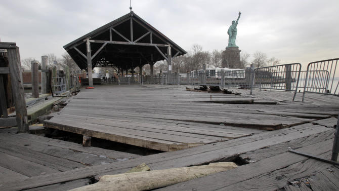Boards of the passenger dock of Liberty Island are askew, damaged from Superstorm Sandy, in New York, Friday, Nov. 30, 2012. Tourists in New York will miss out for a while on one of the hallmarks of a visit to New York, seeing the Statue of Liberty up close. Though the statue itself survived Superstorm Sandy intact, damage to buildings and Liberty Island's power and heating systems means the island will remain closed for now, and authorities don't have an estimate on when it will reopen. (AP Photo/Richard Drew)