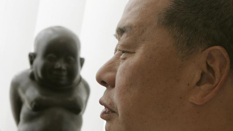 File photo of Jimmy Lai, chairman of Next Media, listening during an interview at his office in Hong Kong