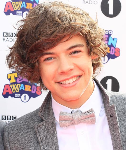 Harry Styles photos: Rocking the retro look with a bow tie, Harry looks delicious.