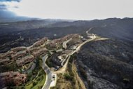 An aerial view of the town of Coin and its surroundings, near Malaga, after the passage of a wildfire