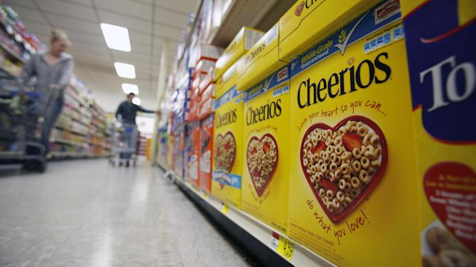 FILE - In this June 16, 2011 file photo, boxes of Cheerios are shown in a store in Akron, N.Y. Cheerios is standing by the fictitious biracial family featured in their latest Heart Healthy campaign, which reflects a black-white racial mix uncommon in commercials today. The 30-second ad, featuring a black dad, white mom and biracial child, produced enough vitriol on YouTube that Cheerios requested the comments section be turned off. (AP Photo/David Duprey, file)
