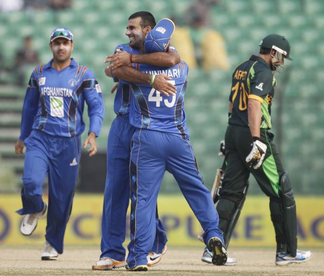 Afghanistan's Shenwari congratulates bowler Zadran as he dismissed Pakistan's Afridi successfully during their Asia Cup 2014 ODI cricket match in Fatullah