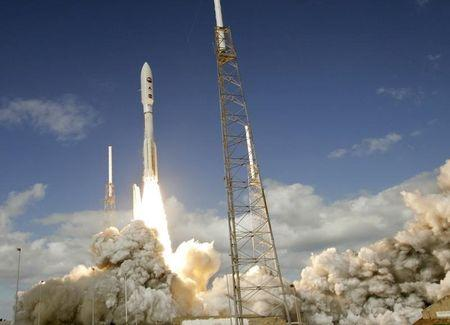 The Atlas V rocket with the New Horizons spacecraft blasts off from complex 41 at the Cape Canaveral..