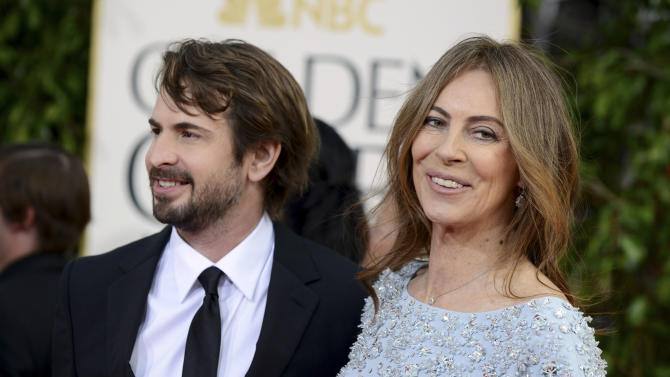 Director Kathryn Bigelow, right, and filmmaker and journalist Mark Boal arrive at the 70th Annual Golden Globe Awards at the Beverly Hilton Hotel on Sunday Jan. 13, 2013, in Beverly Hills, Calif. (Photo by Jordan Strauss/Invision/AP)