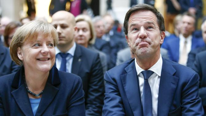 German Chancellor Merkel and Dutch prime minister Rutte attend a ceremony in Berlin