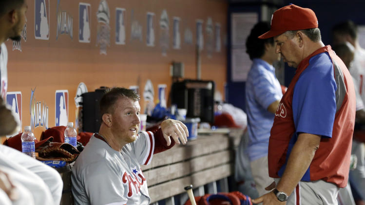 Philadelphia Phillies starting pitcher Zach Miner, left, talks with pitching coach Rich Dubee, right, in the dugout in the fifth inning of a baseball game against the Miami Marlins,Tuesday, Sept. 24, 2013, in Miami. (AP Photo/Lynne Sladky)