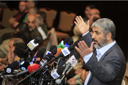 Hamas political leader Khaled Meshal talks to 41 Palestinian released prisoners, in background, upon their arrival in Cairo, Egypt, Tuesday, Oct. 18, 2011. Hundreds of Palestinians freed from Israeli prisons in exchange for the release of Gilad Shalit, the Israeli soldier held for five years by the enclave's Islamist rulers, Hamas .  (AP Photo/Amr Nabil)