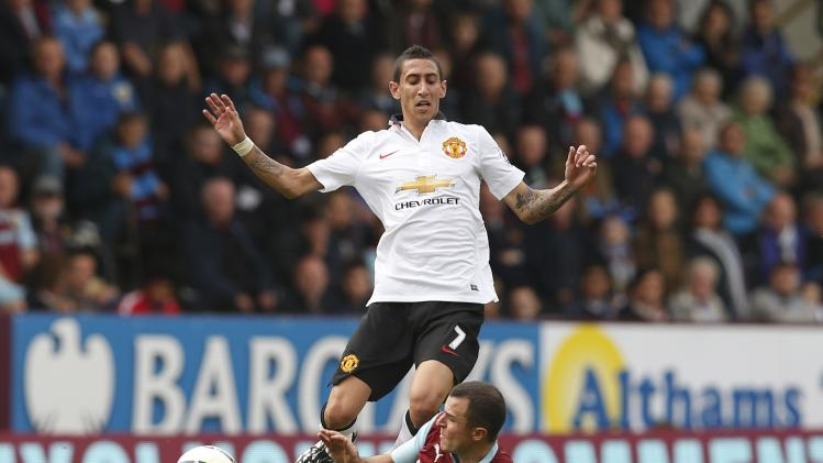 Manchester United's Di Maria is challenged by Burnley's Marney during their English Premier League soccer match at Turf Moor in Burnley