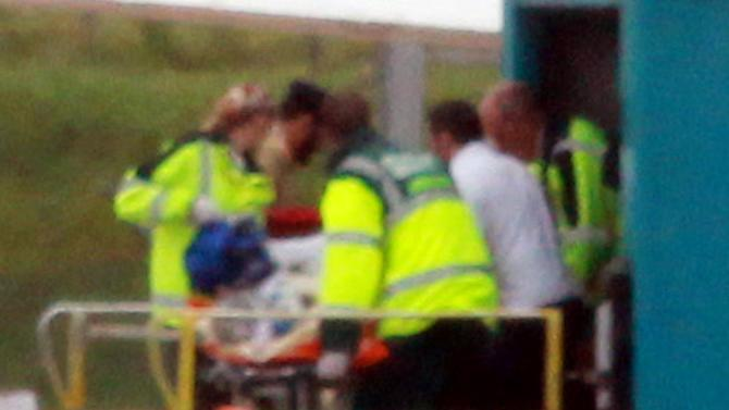 Malala Yousufzai, 14, the Pakistani schoolgirl shot in the head by Taliban gunmen, is transferred from the plane aboard a stretcher as she arrives at Birmingham Airport, England, Monday Oct. 15, 2012.  Malala Yousufzai, will receive medical care by doctors and nurses who are specialists in helping British soldiers wounded in Afghanistan and Iraq, after she was shot on a bus in front of her friends for promoting girls' education and criticizing militants. (AP Photo/David Jones, PA) UNITED KINGDOM OUT - NO SALES - NO ARCHIVES