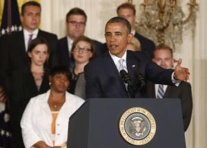 Obama talks before he signs presidential memorandum on reducing burden of student loan debt in White House in Washington