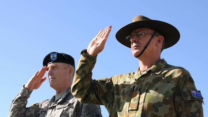 In this Jan. 17, 2013 photo provided by U.S. Army Pacific, U.S. Army Maj. Gen. Roger Mathews, left, and Australian Defence Forces Maj. Gen. Richard Burr salutes during a ceremony welcoming Burr to Fort Shafter, Hawaii. Burr's unprecedented appointment to be deputy commanding general at U.S. Army Pacific is the first time a non-American has served in such a high-ranking position at a command like this.  The move  symbolizes the Army's push to connect more with allies and friendly nations in the Pacific as the Obama administration rebalances national defense strategy toward the region.(AP Photo/U.S. Army Pacific, Angela Kershner)