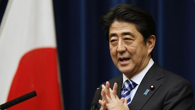 Japan's PM Abe speaks during a news conference to wrap up the ASEAN-Japan Commemorative Summit Meeting at his official residence in Tokyo